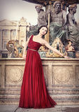 Woman in red dress, in Paris, France Royalty Free Stock Images