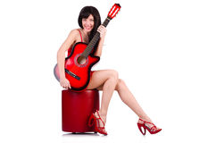 Woman in red dress playing guitar isolated Stock Image