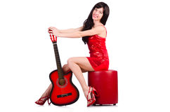 Woman in red dress playing guitar isolated Stock Photos