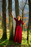Woman in red dress portrait, autumnal forest Royalty Free Stock Images