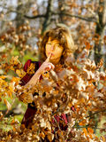 Woman in red dress portrait, autumnal forest Royalty Free Stock Image