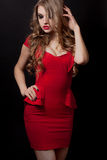 Woman in red dress portrait isolated on black background Royalty Free Stock Photo