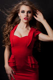 Woman in red dress portrait isolated on black background Stock Image