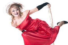 Woman in a red dress posing on a chair Stock Photos