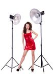 Woman in red dress posing in  studio Royalty Free Stock Photography