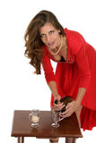 Woman In Red Dress Pouring Drinks Stock Image