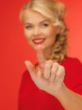 Woman in red dress pressing virtual button Royalty Free Stock Images