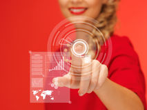 Woman in red dress pressing virtual button Royalty Free Stock Image