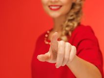 Woman in red dress pressing virtual button Royalty Free Stock Photos
