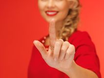 Woman in red dress pressing virtual button Stock Photos