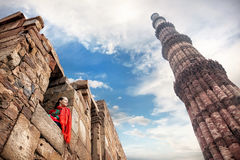 Woman in red dress at Qutub Minar complex Royalty Free Stock Photos