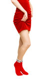 Woman in red dress and red socks. Isolated on white Royalty Free Stock Image