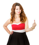 Woman in red dress rude gesturing Stock Photography