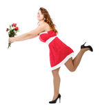 Woman in red dress running Royalty Free Stock Images