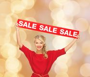 Woman in red dress with sale sign Stock Photo