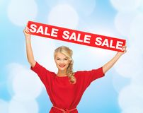 Woman in red dress with sale sign Royalty Free Stock Photo