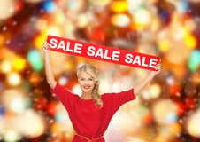 Woman in red dress with sale sign Stock Photography