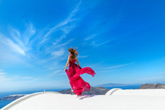 Woman in the red dress and sea Stock Photo