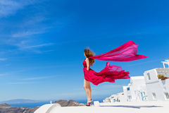 Woman in the red dress and sea Royalty Free Stock Images