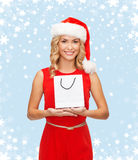 Woman in red dress with shopping bag Stock Image
