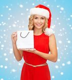 Woman in red dress with shopping bag Royalty Free Stock Photography