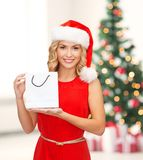 Woman in red dress with shopping bag Royalty Free Stock Photos