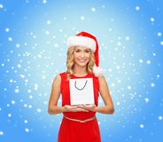 Woman in red dress with shopping bag Royalty Free Stock Images