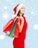 Woman in red dress with shopping bags Stock Photography