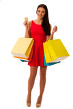 Woman in red dress with shopping bags excited of purchase in mal Stock Photography