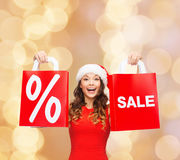 Woman in red dress with shopping bags Royalty Free Stock Photo