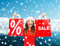 Woman in red dress with shopping bags Stock Images