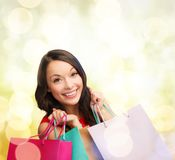 Woman in red dress with shopping bags Royalty Free Stock Photos