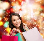 Woman in red dress with shopping bags Stock Image