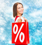 Woman in red dress with shopping bags Stock Photos