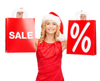 Woman in red dress with shopping bags Stock Photo