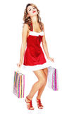 Woman in red dress with shopping bags royalty free stock photography