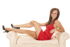 Woman red dress sit side couch Stock Photos