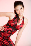 Woman in red dress smiling. Woman smiling in floral red dress Royalty Free Stock Images