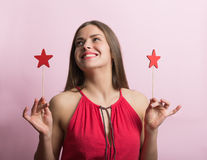 Woman in red dress with stars decor Stock Image
