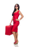 Woman in red dress with suitcase on white Stock Photo