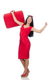 Woman in red dress with suitcase on white Stock Images