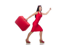 Woman in red dress with suitcase on white Royalty Free Stock Photo