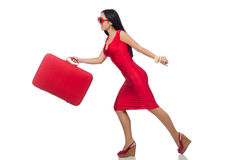 Woman in red dress with suitcase on white Royalty Free Stock Images