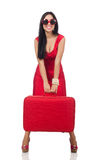 The woman in red dress with suitcase on white Stock Photos