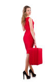 Woman in red dress and travel case isolated Stock Image