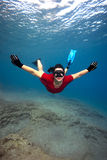 Woman in red dress underwater Royalty Free Stock Image