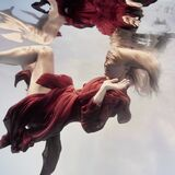 Woman in red dress underwater