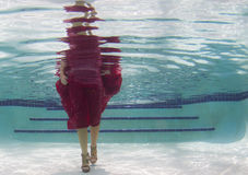 Woman in a red dress underwater Royalty Free Stock Photo