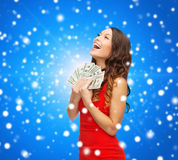 Woman in red dress with us dollar money Stock Photo