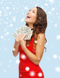 Woman in red dress with us dollar money Stock Image